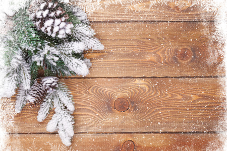 december: Old wood texture with snow and firtree christmas background