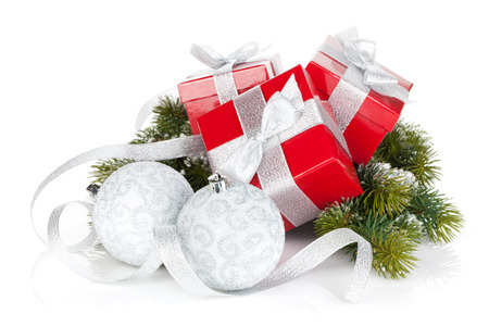 three gift boxes: Three christmas gift boxes with baubles. Isolated on white background