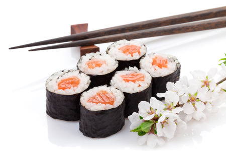 Sushi maki set and sakura branch. Isolated on white background Stock Photo