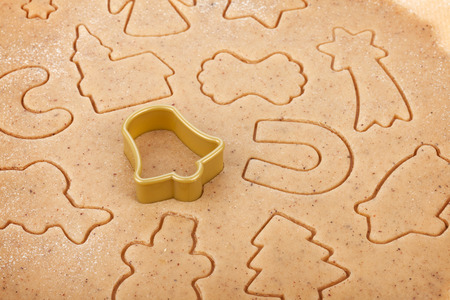 Gingerbread dough for christmas cookies with cutter photo