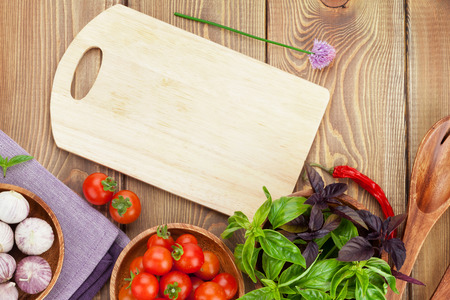 cutting boards: Fresh farmers tomatoes and basil on wood table. View from above with copy space Stock Photo