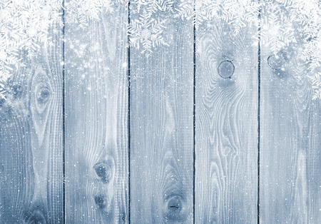 snow flakes: Blue wood texture with snow christmas background
