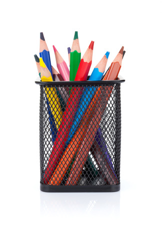 Colorful pencils in holder. Isolated on white background photo