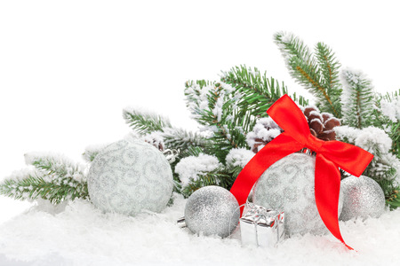 Christmas baubles with red ribbon and fir tree. Isolated on white background photo