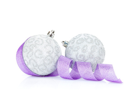 Christmas baubles and purple ribbon. Isolated on white background photo