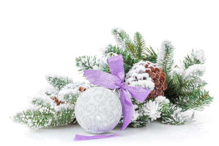 Christmas bauble with purple ribbon and fir tree. Isolated on white background photo