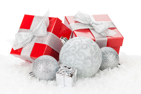 traditional gifts: Christmas baubles and red gift boxes. Isolated on white background