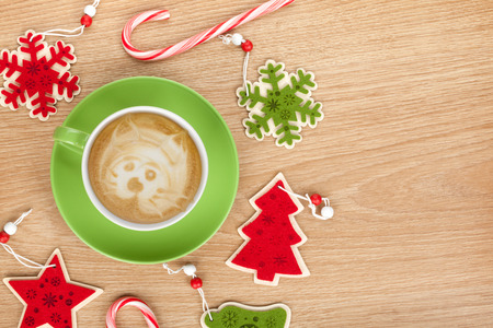 green and white: Christmas decor and coffee cup over wooden table background with copy space Stock Photo