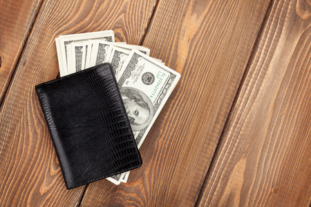 money wallet: Money cash wallet on wooden table with copy space Stock Photo