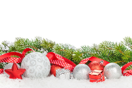 happy holidays: Christmas baubles and red ribbon with snow fir tree. Isolated on white background with copy space