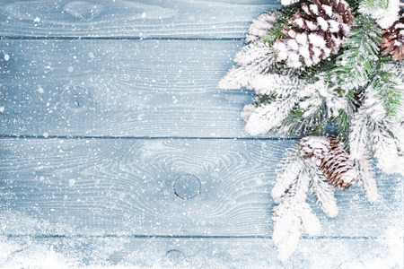 white card: Old wood texture with snow and firtree christmas background