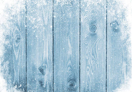 winter season: Blue wood texture with snow christmas background