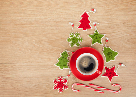Christmas decor and coffee cup over wooden table background with copy space photo