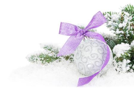 christmas tree purple: Christmas bauble and purple ribbon with snow fir tree.