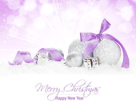 silver balls: Christmas colorful decor over snow.  Stock Photo