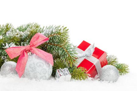 Christmas colorful decor, gift box and snow fir tree.  photo