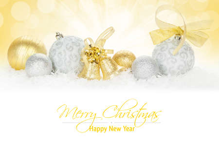 gold ornament: Christmas colorful decor over snow.  Stock Photo
