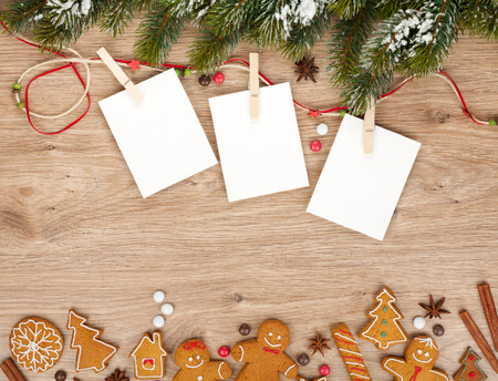Blank christmas photo frames with fir tree and gingerbread cookies photo