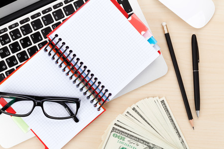 space for copy: Office table with pc, supplies and money cash. View from above with notepad for copy space Stock Photo