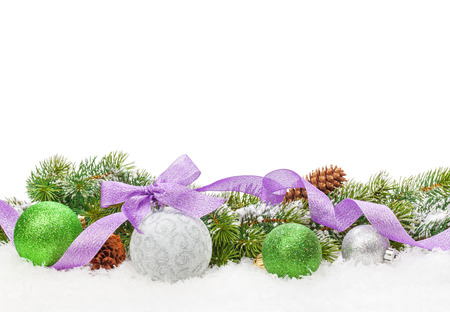 Christmas decor and snow fir tree. Isolated on white background with copy space photo