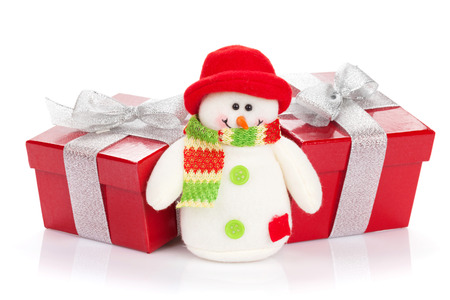 Christmas gift boxes and snowman toy. Isolated on white background photo