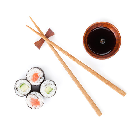Sushi set, chopsticks and soy sauce. Isolated on white background
