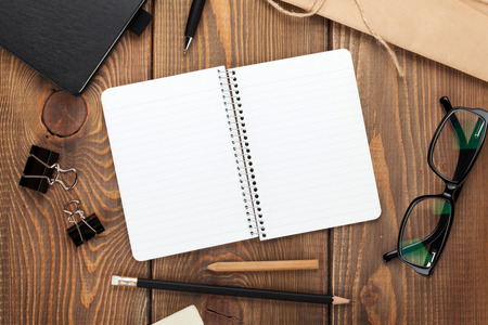 pen: Office table with notepad, vintage envelope and supplies. View from above with copy space Stock Photo