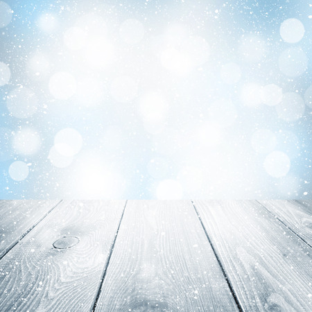 ice cold: Christmas winter background with wooden table and blurred bokeh