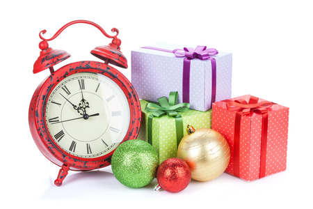 Christmas clock, gift boxes and bauble decor. Isolated on white background photo