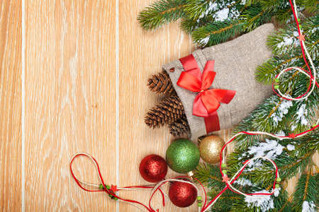 Christmas wooden background with snow fir tree, decor and copy space photo