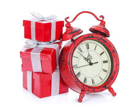 Christmas gift boxes and clock. Isolated on white background photo