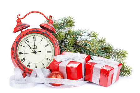 Christmas gift boxes, clock and snow fir tree. Isolated on white background photo