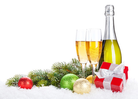 holiday party: Champagne, christmas decor and gift box over snow and fir tree with copy space Stock Photo