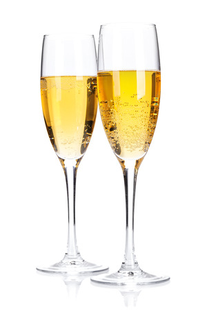 Two champagne glasses. Isolated on white background photo