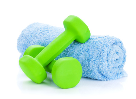 Two green dumbells and towel. Isolated on white background photo