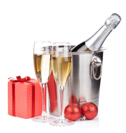 christmas drink: Christmas champagne in bucket and gift box. Isolated on white background