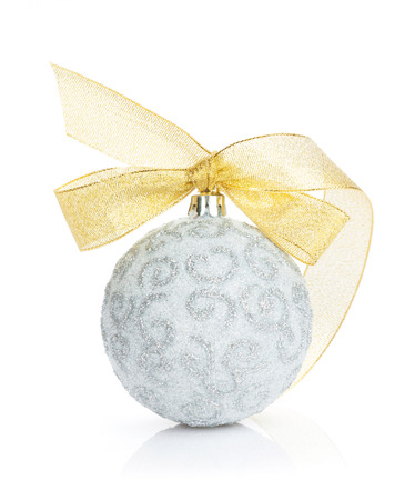 Christmas bauble with golden ribbon. Isolated on white background photo