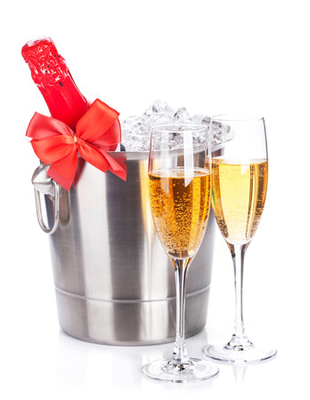 Two champagne glasses and bottle in cooler. Isolated on white background photo