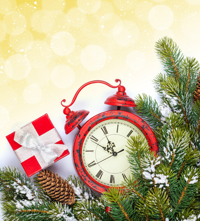twelve month old: Christmas background with clock, gift box, snow fir tree and copy space with bokeh