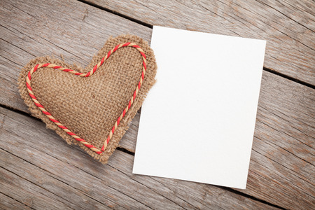 wood frame: Photo frame or greeting card and valentines day toy heart over wooden background