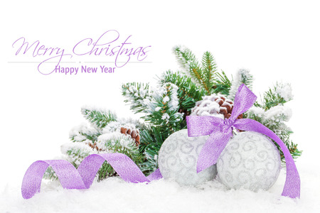 christmas tree purple: Christmas baubles and purple ribbon with snow fir tree. Isolated on white background with copy space
