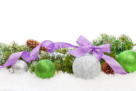 Christmas decor and snow fir tree. Isolated on white background with copy space