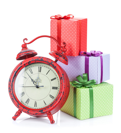 Christmas clock and three gift boxes. Isolated on white background photo