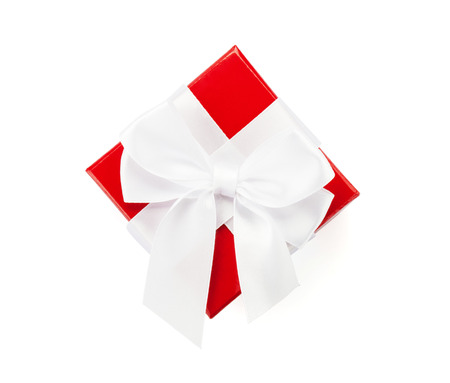 Red gift box with white ribbon. Isolated on white background, view from above photo