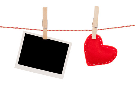 Photo frame and valentines day toy heart hanging on rope. Isolated on white background photo