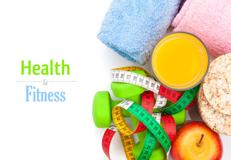 Dumbells, tape measure, healthy food and towels. Fitness and health. Isolated on white background photo