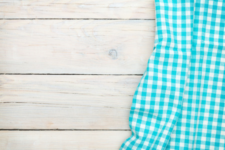 picnic cloth: Blue towel over wooden kitchen table. View from above with copy space Stock Photo