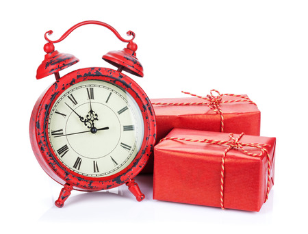 Christmas clock and two gift boxes. Isolated on white background photo