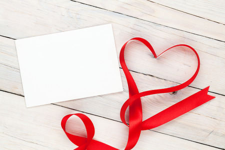 Photo Frame Or Greeting Card With Valentines Heart Shaped Ribbon Over  Wooden Table Background Stock Photo