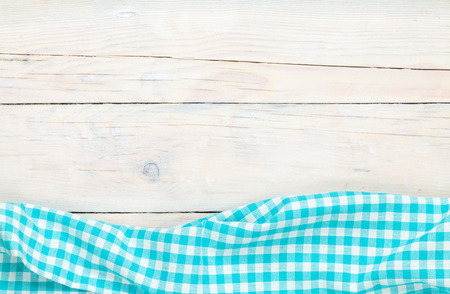 fabric cotton: Blue towel over wooden kitchen table. View from above with copy space Stock Photo